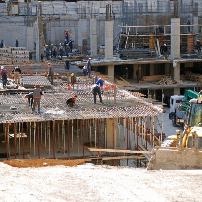 building under construction with worker
