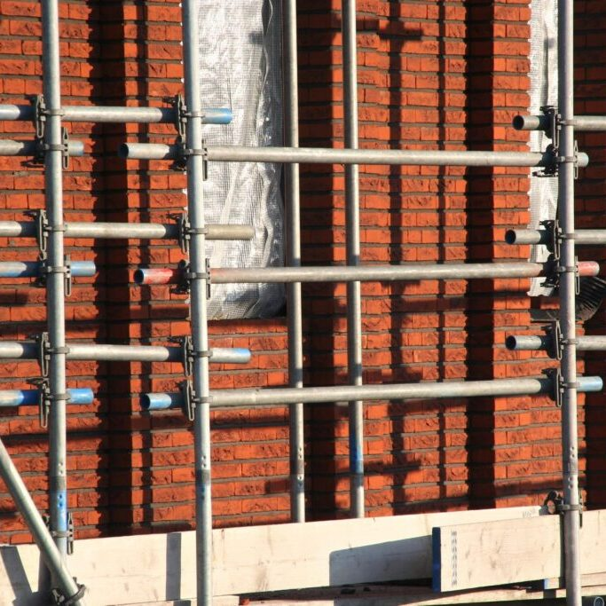 building house with scaffolding